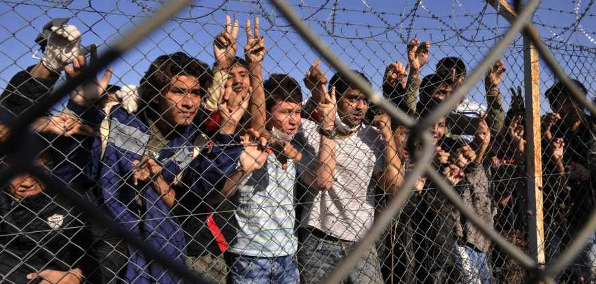 Child immigrants stand behind a fence at a detention center in the northeastern Greek village of Filakio near the Greek-Turkish border on Friday, Nov. 5, 2010.  For the first time, the EU's border agency Frontex is deploying rapid intervention teams, and the 175-strong force arrived with officers drawn from 26 countries (AP Photo/Nikolas Giakoumidis)
